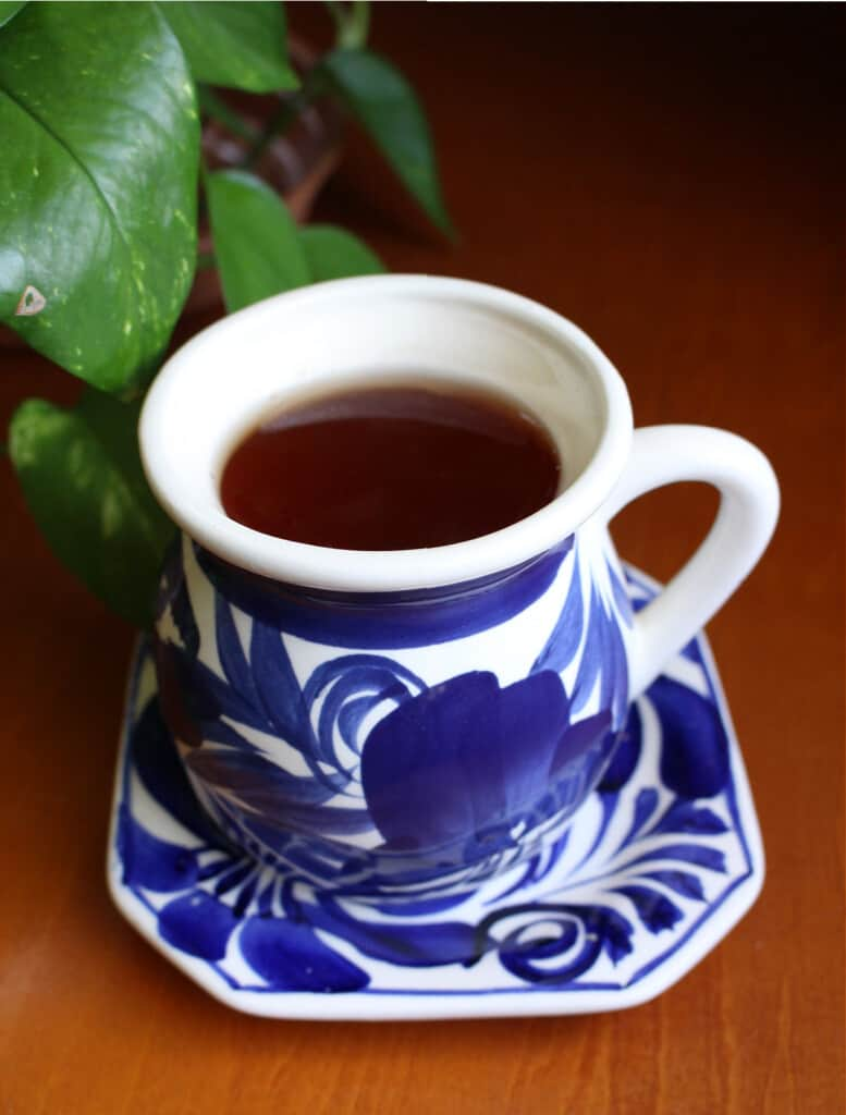 Anti inflammatory tea in a decorative blue mug.