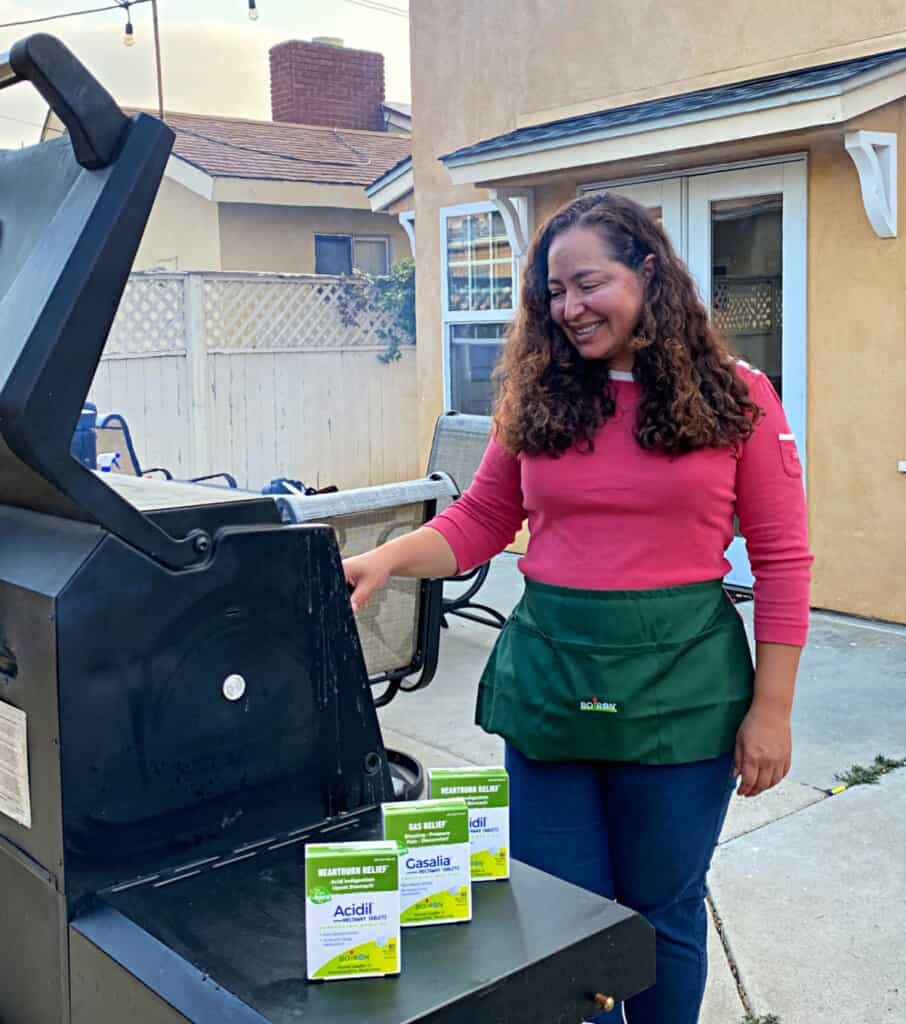 Maggie Unzueta grilling in a backyard.