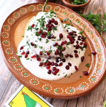 Chiles en Nogada plated and on a decorative Mexican clay plate.