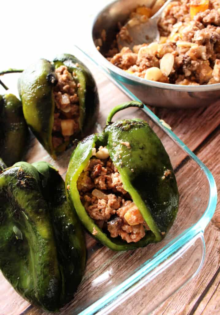 Roasted poblano peppers that are stuffed with a meat filling.